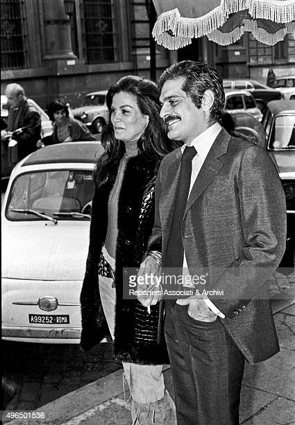The Egyptian actor Omar Sharif walking arm in arm with the Brazilian actress Florinda Bolkan in the street after a press conference for the launching...