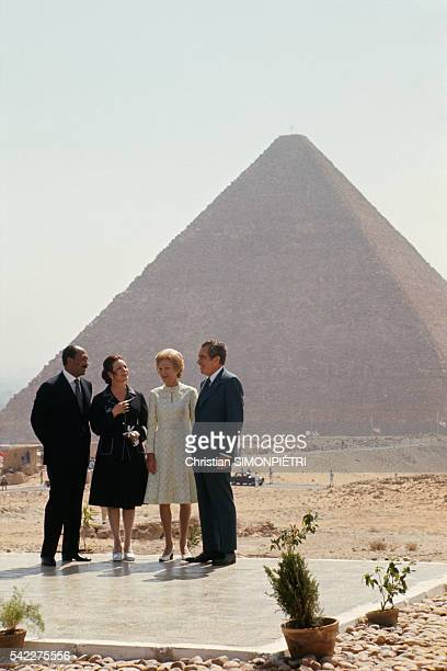 The Egyptian and American President Anwar al Sadat and Richard Nixon accompanied by their wives Jehan and Pat pose by the Pyramids