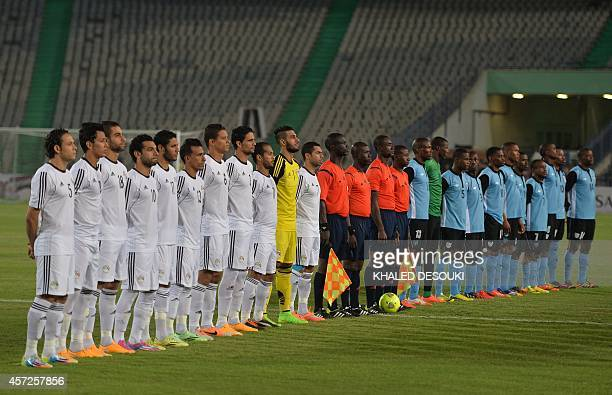The Egyptian and Botswana national football teams lineup prior to their Africa Cup of Nations 2015 qualifying football match at Cairo stadium in the...