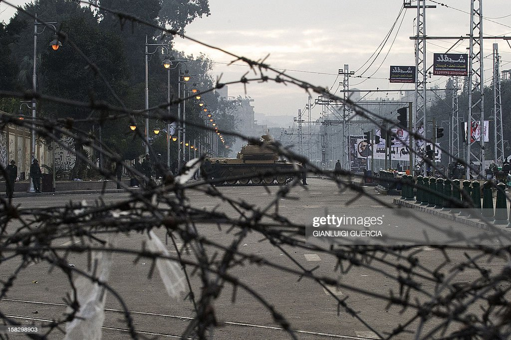 The Egyptian army deploys outside the presidential palace in Cairo on December 13, 2012. Egypt's crisis showed no sign of easing as the army delayed unity talks meant to ease political divisions and the opposition set near-impossible demands for taking part in a looming constitutional referendum.