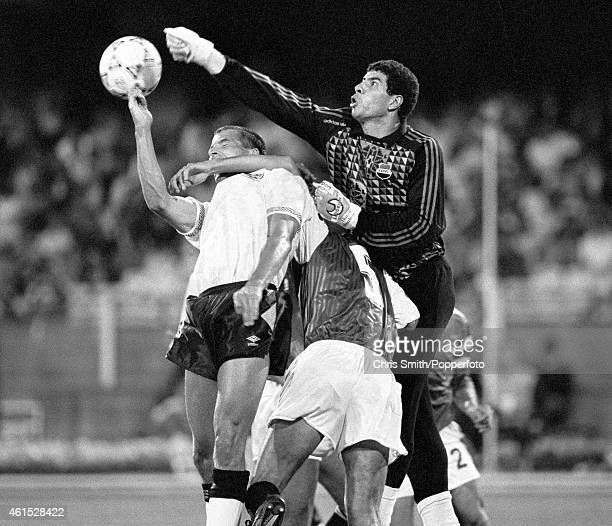 The Egyptian goalkeeper Ahmed Shoubeir punches the ball away under pressure from England striker Steve Bull during the FIFA World Cup match between...