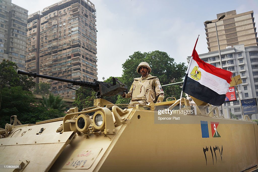 The Egyptian military stands guard at a roadblock in the district of Giza the morning after the first democratically elected President Mohammed Morsi was ousted from power and put under house arrest on July 4, 2013 in Cairo, Egypt. Adly Mansour has been sworn in as the interim head of state as unrest continues to spread throughout the country. Since Sunday there have been approximatley 50 deaths.