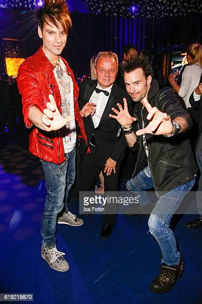 The Ehrlich brothers Christian Ehrlich and Andreas Ehrlich with Super Illu chief editor Stefan Kobus during the Goldene Henne after show party on...