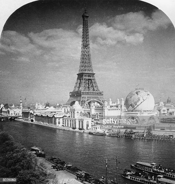 The Eiffel Tower and 'Globe Celeste' at the 1900 World Exposition viewed from the Right Bank of the River Seine River Paris France