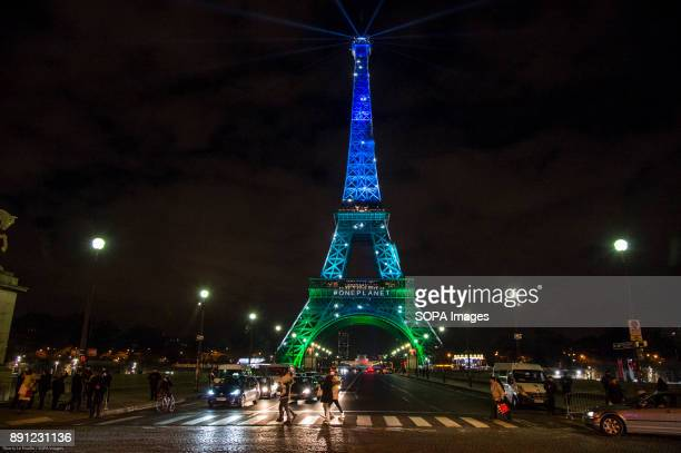The Eiffel Tower in the colors of the new summit on the climate organized by French president Emmanuel Macron