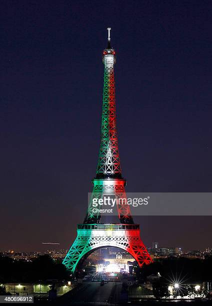 The Eiffel Tower is enlightened with colors of the Mexican national flag prior to the beginning of the fireworks on July 14 2015 as part of France's...