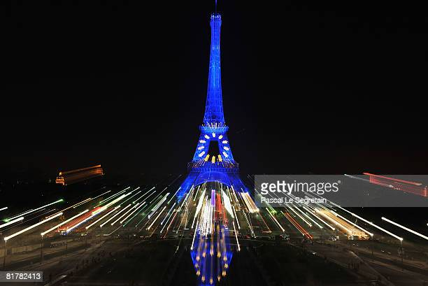 The Eiffel Tower is illuminated in blue with gold stars representing the EU flag to mark the French European Union presidency on June 30 2008 in...