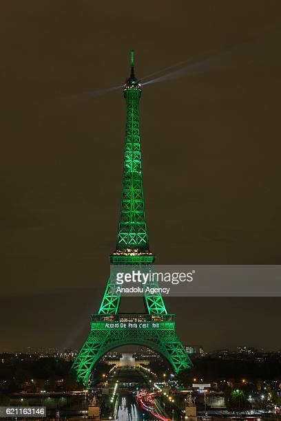 The Eiffel Tower is illuminated in green to celebrate the ratification of the COP21 climate change agreement in Paris, France on November 04, 2016.