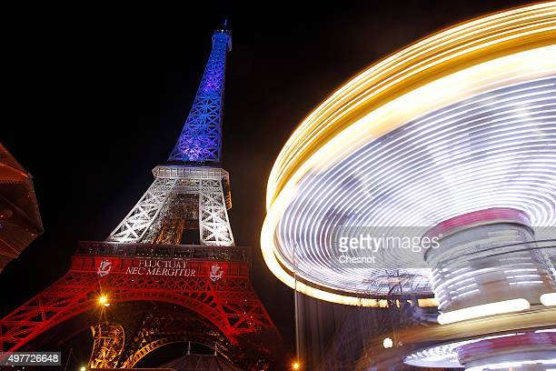 The Eiffel Tower is illuminated in Red White and Blue in honour of the victims of Friday's terrorist attacks on November 18 2015 in Paris FranceThe...