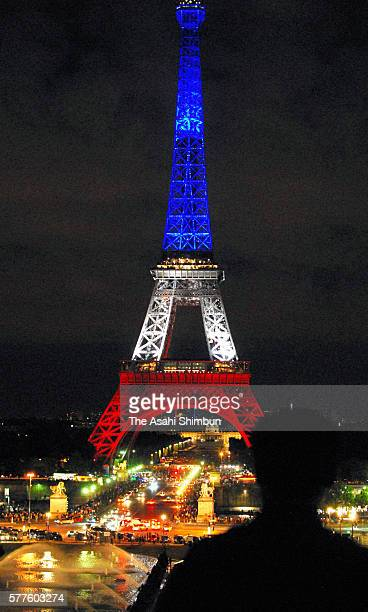 The Eiffel Tower is illuminated in tricolour to commemorate the victims of the terror attack in Nice on July 16 2016 in Paris France