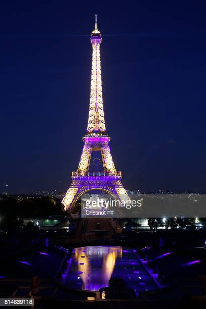 The Eiffel Tower is illuminated prior to a Fireworks as part of Bastille Day celebrations on July 14 2017 in Paris France The theme of the fireworks...