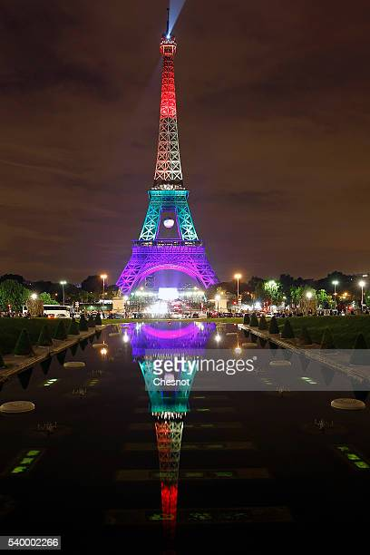 The Eiffel Tower is lit up in the colors of the rainbow flag to pay a tribute for victims of a shooting inside a gay nightclub, Pulse Club in...