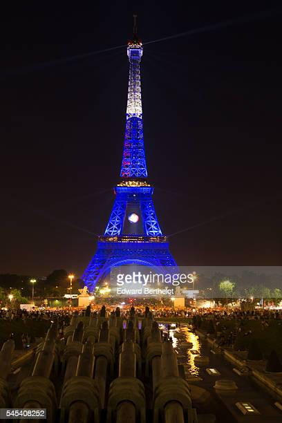 The Eiffel tower is lit up in the colors representing France for the 'EURO 2016' Twitter contest organized by French telecom operator 'Orange', at...