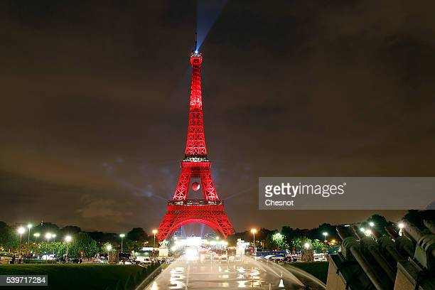 """The Eiffel tower is lit up in the colors representing Turkey for the 'EURO 2016' Twitter contest organized by French telecom operator """"Orange"""" on..."""