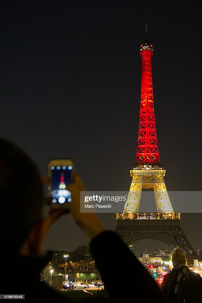 The Eiffel tower is lit up in the colours of the Belgian flag on March 22, 2016 in Paris, France. The tower has been lit-up in solidarity with the Brussels victims following bomb attacks which are thought to have been killed at least 34 people after Brussels airport and a Metro station were targeted by explosions. .