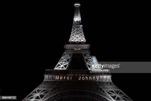 The Eiffel Tower is lit up with the message Merci Johnny in Paris on December 8 in memory of the late French rock star Johnny Hallyday French music...
