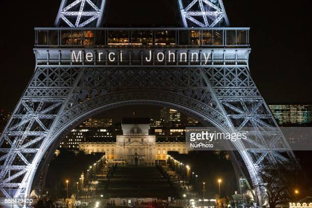 The Eiffel Tower is lit up with the message quotMerci Johnnyquot in Paris on December 8 in memory of late French rock star Johnny Hallyday French...
