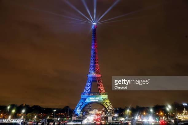 The Eiffel tower is lit with the colours of the Olympic flag with the words 'Made For Sharing' during the launch of the international campaign for...