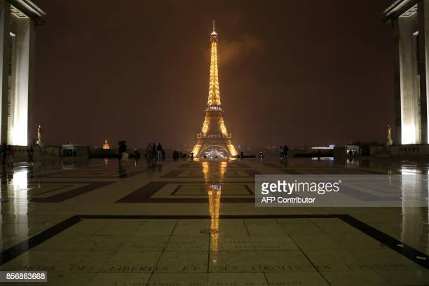 The Eiffel Tower is pictured in Paris before switching off lights on October 2 2017 in tribute to the victims of the attacks in Las Vegas and...