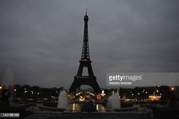 The Eiffel Tower is seen after the lights are turned off during Earth Hour 2012 on March 31 2012 in Paris France cAcording to organisers the biggest...