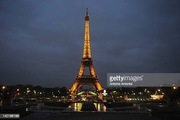 The Eiffel Tower is seen before the lights are switched off for Earth Hour 2012 on March 31 2012 in Paris France According to organisers the biggest...