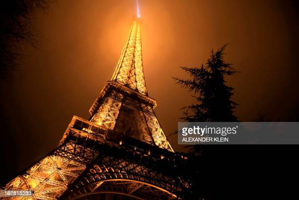 The Eiffel tower is seen on a foggy night in Paris on February 28 2013 The tower was completed in 1889 and it's current total height is 324 meters...