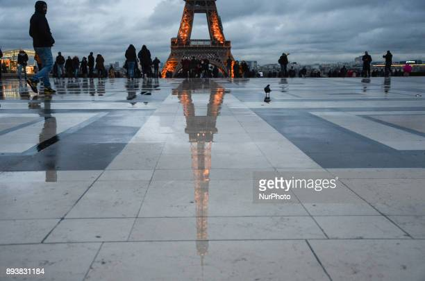 The Eiffel Tower is seen reflected in the water at Trocadero place where a lot of people gather to take a pictures Paris FrancePeople and tourists...