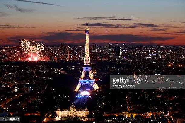 The Eiffel Tower is shown lit up prior a fireworks show to celebrate Bastille Day on July 14 2014 in Paris France Bastille Day commemorates the...