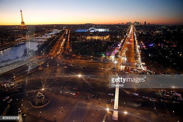 The Eiffel Tower Luxor obelisk in the centre of 'Place de la Concorde' the 'Grand Palais' and the ChampsElysees Avenue are seen at sunset on November...