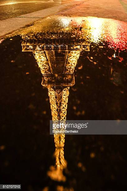 The Eiffel Tower reflecting into a puddle on February 5 2016 in Paris France
