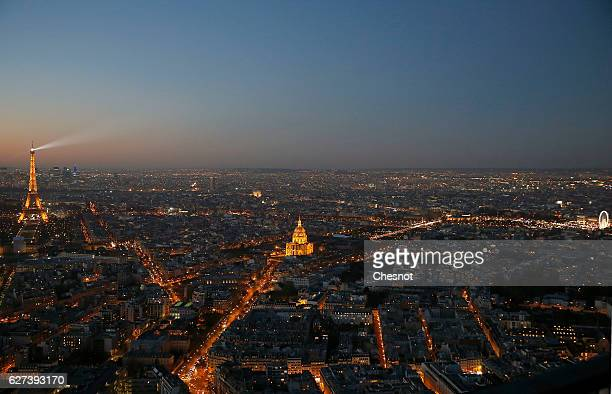 The Eiffel tower the Hotel des Invalides and the streets of Paris illuminated are seen at sunset on December 03 2016 in Paris France The city of...