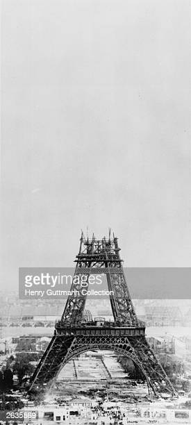 The Eiffel Tower under construction in Paris France No 7 in a series of 11 Théophile Féau captured the construction of the tower by taking...
