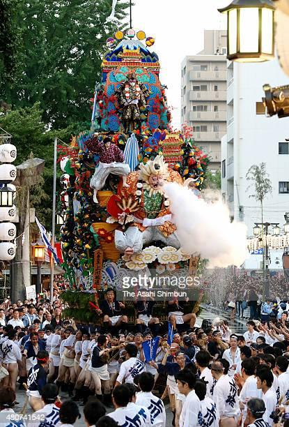 The eight float 'Kamikawabata Dori' rushes through Seido Street of Kushida Jinja Shrine during the Hakata Gion Yamakasa festival on July 15 2015 in...