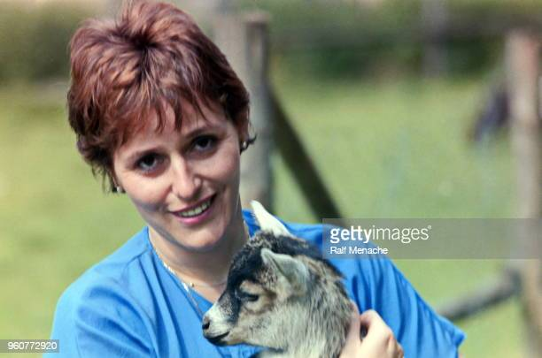 The eighties. The young woman and the baby goat.