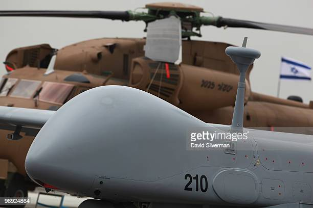 The Eitan the Israeli Air Force's latest generation of Unmanned Aerial Vehicle is displayed alongside a CH53 helicopter during a ceremony intoducing...