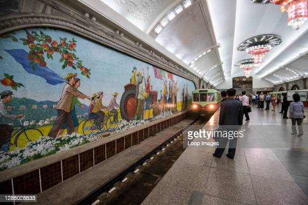 The elaborate Pyongyang Metro stations covered in chandeliers with colourful mosaics and carriages from East Germany.