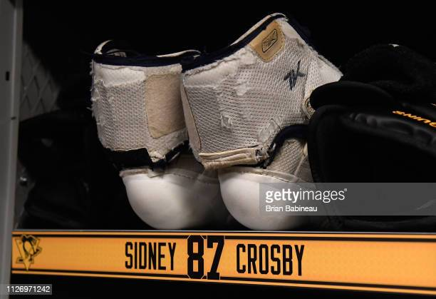 The elbow pads of Sidney Crosby of the Pittsburgh Penguins are seen in the locker room ahead of the 2019 Coors Light NHL Stadium Series game between...
