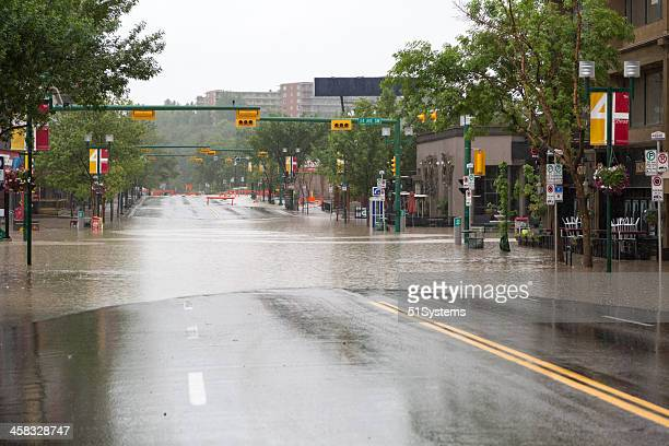 The Elbow River flows over 4th Street.