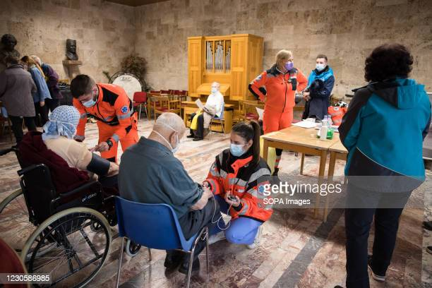 The elderly and their escorts are monitored for possible side effects after vaccination against COVID-19 in the town hall in Kranj. Voluntary mass...
