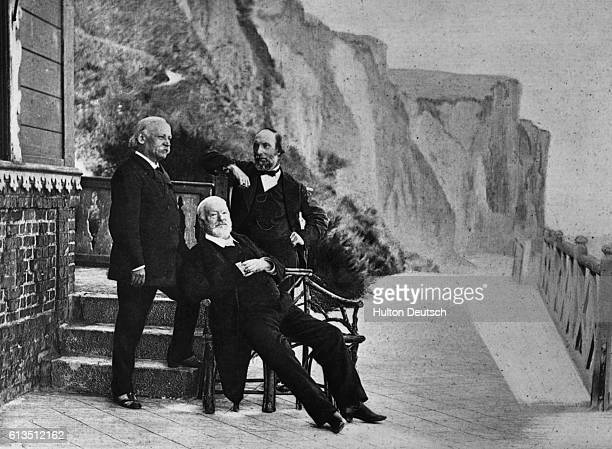 The elderly poet and writer Victor Marie Hugo , with friends on the balcony of his home in Guernsey in the Channel Islands, where he lived in exile...