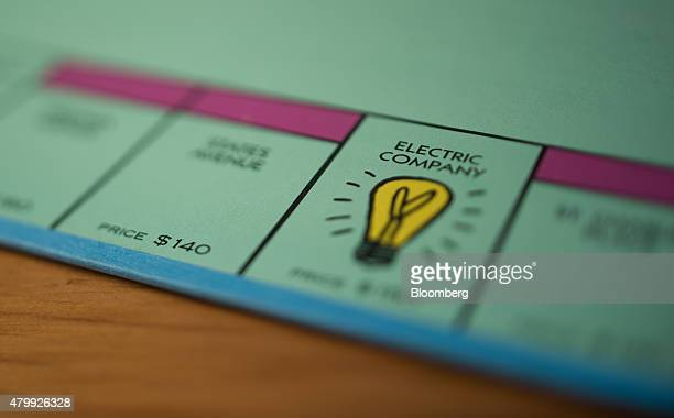 """The """"Electric Company"""" utility square is seen on a Hasbro Inc. Monopoly board game arranged for a photograph taken with a tilt-shift lens in Oradell,..."""
