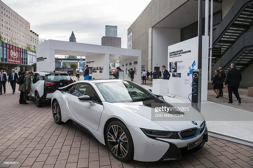 The Electric Powered BMW I8 (R) And I3 Are Seen Next To A Charging