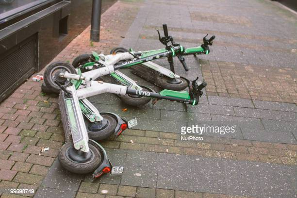 The electric scooters are seen laying on the ground upon Storm Sabine arrival on February 9 2020 in Cologne Germany