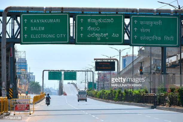 The Electronic City road that leads to the technology hub of Bangalore is seen partially deserted during a one-day nationwide Janata curfew imposed...