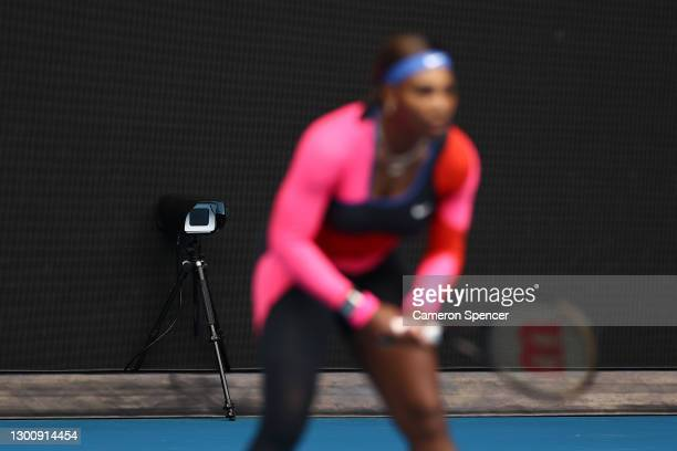 The electronic line judge is seen as Serena Williams of The United States of America prepares to return serve in her Women's Singles first round...