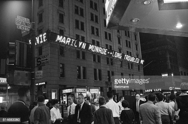 The electronic message board on the New York Times Building on Broadway announces the death of Marilyn Monroe by barbituate overdose on August 5th...
