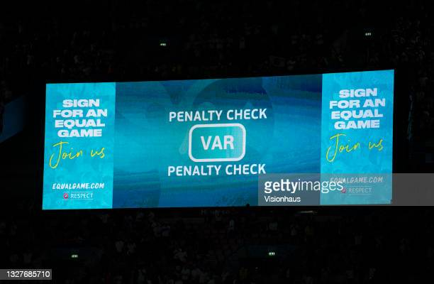 The electronic scoreboard displaying a penalty check by VAR for the England winning penalty during the UEFA Euro 2020 Championship Semi-final match...