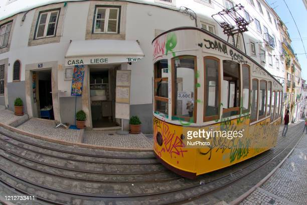 the Elevador da Bica in The bohemian Bairro Alto in Lisbon has steep cobbled streets through which tourists pass Many of the neighborhood's...