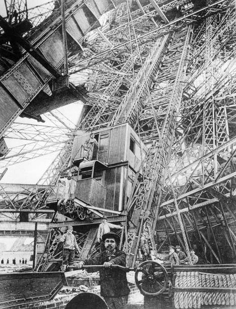 The elevator at the first level of the Eiffel Tower,...