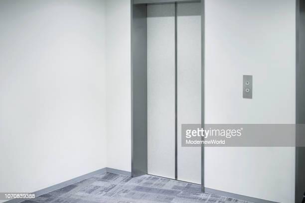 the elevator hall and the white wall - エレベーター ストックフォトと画像